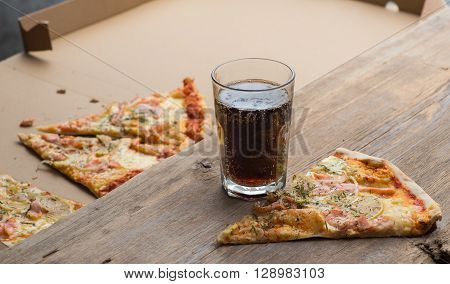 Delicious Salmon Pizza And Coke On A Wooden Table