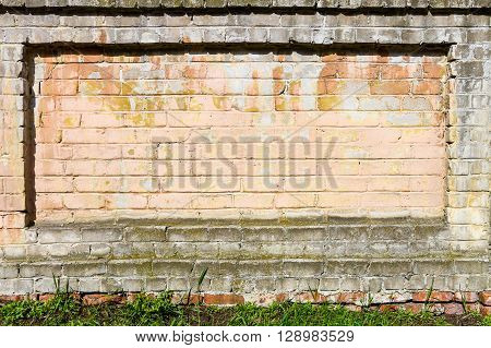 Old weathered wall of bricks and a ground