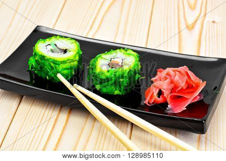 Sushi Roll with Chukoy, Salmon and Cheese. Studio Photo