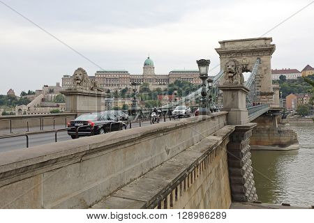 BUDAPEST HUNGARY - JULY 13: Chain Bridge in Budapest on JULY 13 2015. The Szechenyi Suspension Bridge That Spans the River Danube Between Buda and Pest in Budapest Hungary.