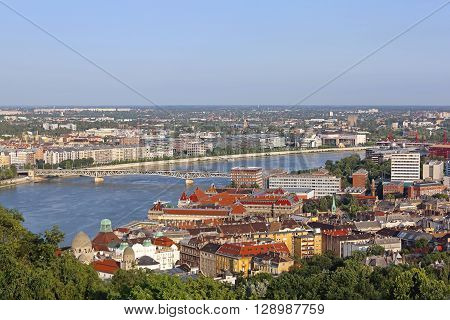 BUDAPEST HUNGARY - JULY 09: River Danube South Cityscape in Budapest on JULY 09 2015. Afternoon South City Panorama From Citadella in Budapest Hungary.