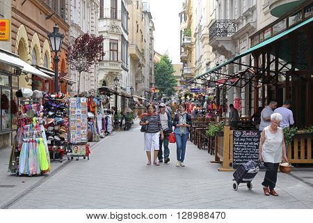 BUDAPEST HUNGARY - JULY 13: Tourists Walking at Vaci Street in Budapest on JULY 13 2015. People Walking at Vaci Street Reserved For Pedestrians in Downtown Budapest Hungary.