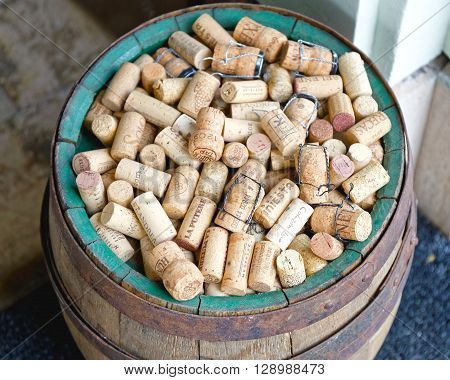 BUDAPEST HUNGARY - JULY 13: Wine Corks in Barrel in Budapest on JULY 13 2015. Big Bunch of Wine Cork Stoppers in Barrel in Budapest Hungary.