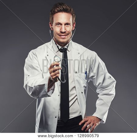 Handsome Doctor With White Lab Coat And Black Tie