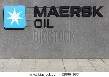Esbjerg, Denmark - May 6, 2016: Maersk oil logo on a wall. Maersk oil is a Danish oil and gas company owned by the A. P. Moller-Maersk Group