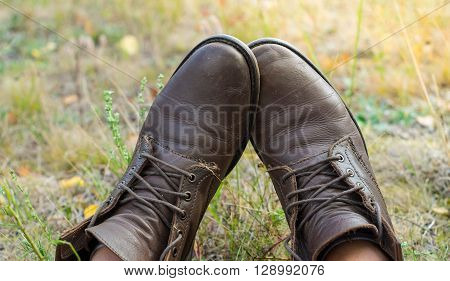 A Pair Of Worn Brown Leather Shoes Over The Countryside Background