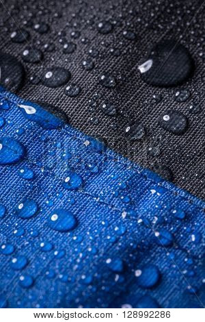 Waterproof coating background with water drops, close up
