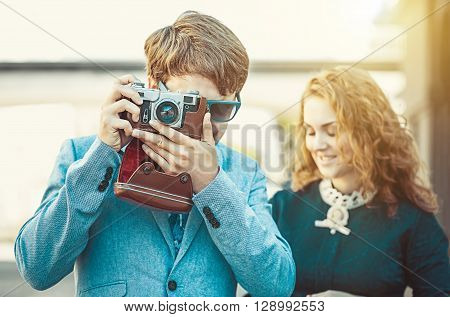 Hipster man wants to take a picture using your vintage camera