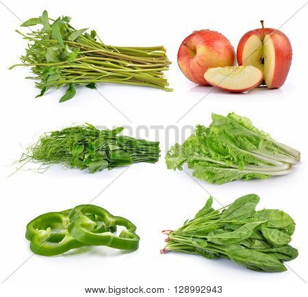 Sliced green pepper Bunch of fresh chayote spinach apples lettuce morning glory on white background