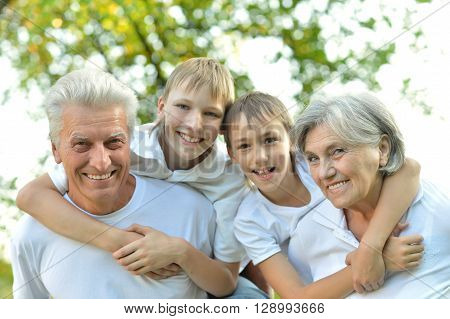 Portrait of a grandparents and grandchildren wolking together