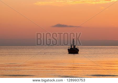 Lonely Fisher's Boat In The Sunset