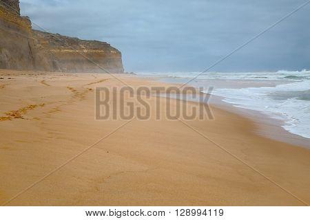 Sandy beach with big waves