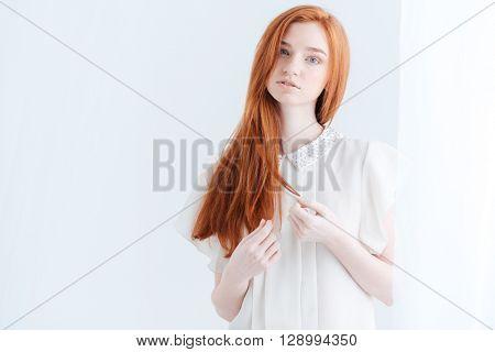 Beautiful redhead woman looking at camera