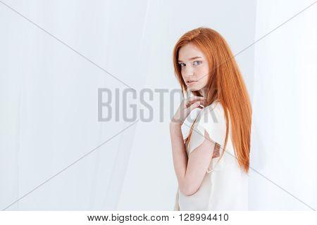 Charming redhead looking back at camera