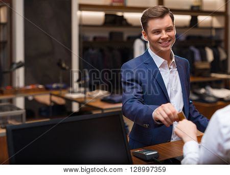 Young man at counter in store