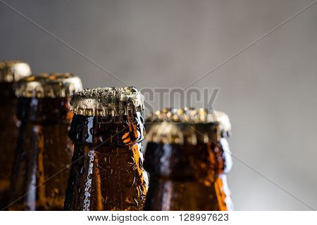 Ice Cold Beer Bottles With Drops Of Dew