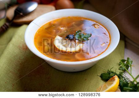 Solyanka russian soup with meat and olives