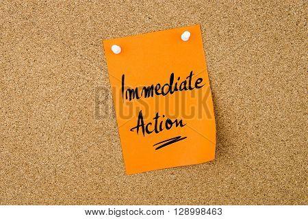 Immediate Action Written On Paper Note