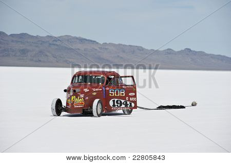 WENDOVER, UT - AUGUST 13: A 1942 Studebaker with its parachute deployed on the Bonneville Salt Flats during Bonneville Speed Week on August 13, 2011 near Wendover, UT.