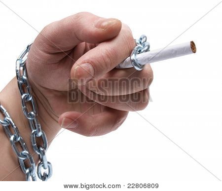 Color photo of a man's hand and a metal chain