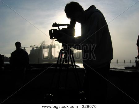 Silhouetted Camera Operator