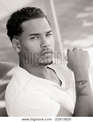 sexy young  adult african american man outside in city
