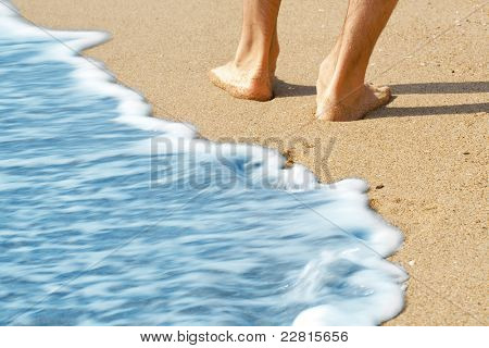 hike along the beach with bare feet