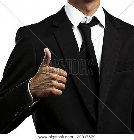 Closeup of a business man showing thumbs up sign