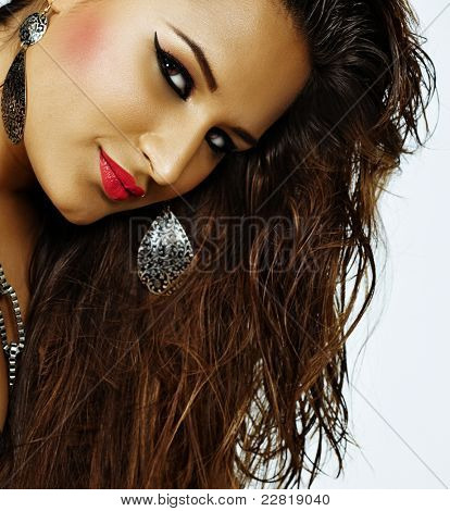 beautiful happy latin woman with tan skin and bright summer make-up with pink lipstick and eyeliner wearing wet long hair