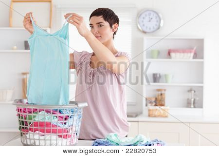 Woman folding clothes in a utility room