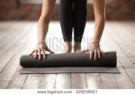 poster of Young Woman Rolling Black Fitness Or Yoga Mat Before Or After Sport Practice, Working Out At Home In