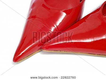 closeup of a pair of women pointy red patent leather shoes