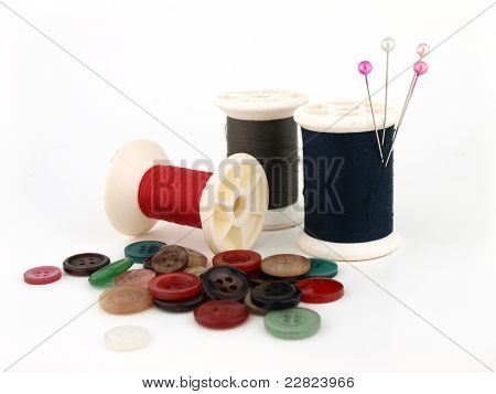 A Spool Of Thread, Needle And Button