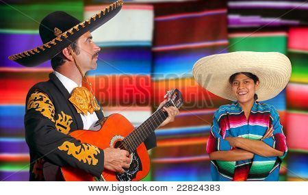 Mexican mariachi charro man and poncho Mexico girl with serape blurred background [Photo Illustration]