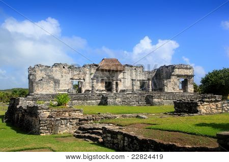 Ancient Tulum Mayan temple ruins in Mexico Quintana Roo under blue sky