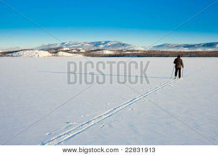 Cross-country Skier On Frozen Lake