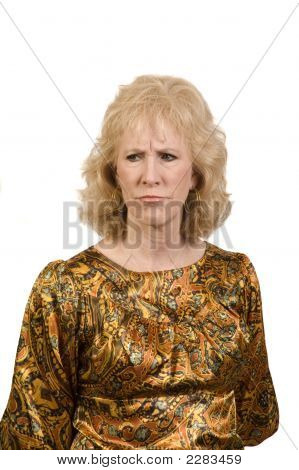 Middle-Aged Woman Frowning Over Something