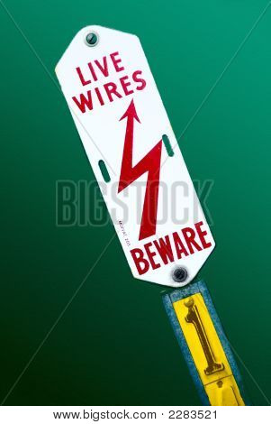 Electrical Warning Sign On Green