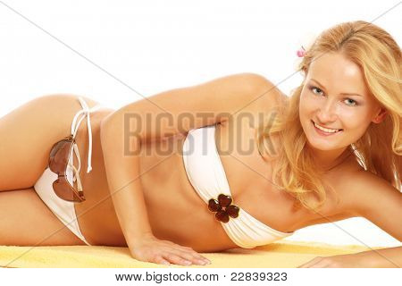 Stock photo of young fit woman in white bikini isolated on white