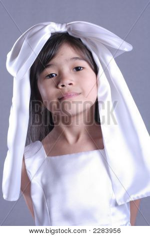 Cute Little Girl Playing Dress Up With Satin Bow On Head