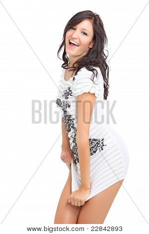 Cute brunette laughing and posing