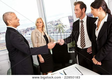 Business people exchange business cards