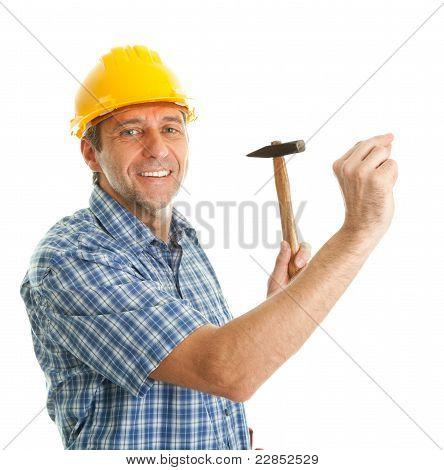 Confident worker hammering in