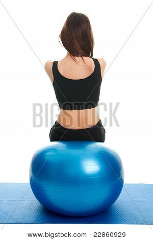 Fitness women exercising on fitness ball