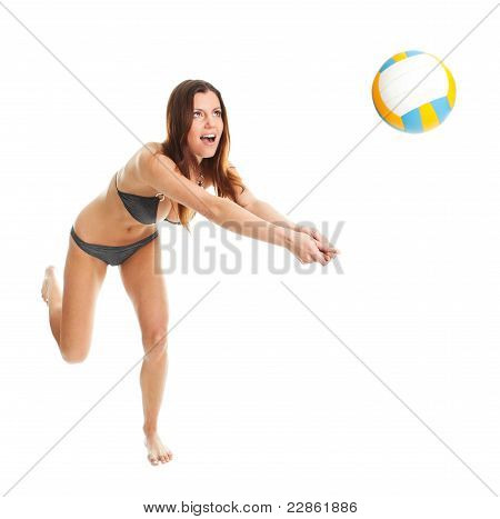 Volleyball player woman in swimwear