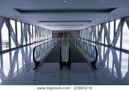 the empty escalator inside the contemporary building