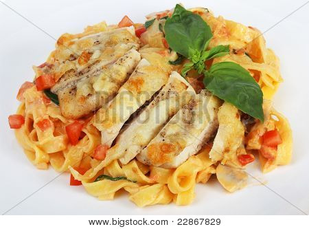 Pasta With Grilled Chicken And Tomatoes, Sprinkled With Freshly Ground Black Pepper