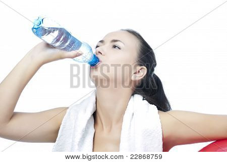 Sportswoman With Bottle Of Pure Water Drinking With Pleasure Isolated