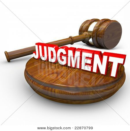 Judgment word on a wooden block and a judge's gavel beside it illustrating the power and decisiveness of the court system in declaring a verdict as a final decision