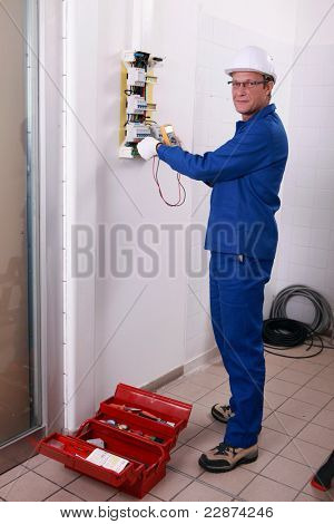 Electrician with helmet and overalls